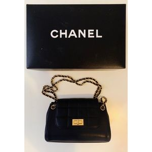 Authentic Chanel mini flap bag on chain black gold